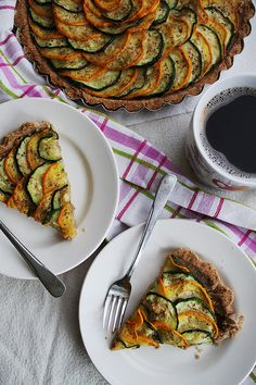 Zucchini tart / For the crust: 2 cups whole wheat flour 1 tsp salt ¼ cup olive oil About ½ cup ice-cold water  For the filling: 1 small green zucchini 1 small yellow zucchini Olive oil Dried oregano Kosher salt and freshly ground black pepper
