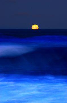 Moon sinking into the Atlantic ocean