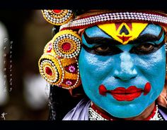A Kathakali dancer from Kerala, India.    This dance/art form originated in the country's present day state of Kerala during the 17th century and has developed over the years with improved looks, refined gestures and added themes besides more ornate singing and precise drumming.  ..... Explore Dream Discover INDIA with http://10yearitch.com/