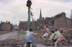 Young girls playing in the slums of Manchester in 1965.