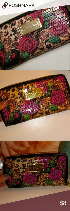 Betsey Johnson Sequin wallet Betsey Johnson Sequin Rose patterned wallet. Inside has metallic gold material. Lots of space for cards, cash, etc. No missing sequins. Betsey Johnson Bags Wallets
