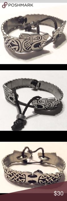 Twin Beast Dragon Bracelet St Justin Celtic gypsy St Justin Twin Beast double dragon head Bangle! Solid hand cast pewter torc is adjustable with leather and pewter thong. Made in Cornwall, stamped. Will fit 5-7 inch wrist easily.  Bands are about .5 inch in width with dragon heads nearly .75 inch width.  Excellent piece for eclectic boho traveler, festival lover, goth Anglo Saxon SCA ... St. Justin Jewelry Bracelets