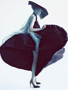 Bottega Veneta Dress and Giorgio Armani straw hat, shot by Oliver Stalmans