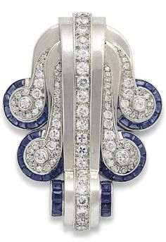 RENÉ BOIVIN - AN ART DECO SAPPHIRE AND DIAMOND BROOCH, CIRCA 1936. Of tiered scrolling design, each scroll set with circular-cut diamonds to the calibré-cut sapphire-set terminal, 5.0 cm, with French assay marks for platinum and gold, maker's mark of René Boivin. #Boivin #ArtDeco #brooch