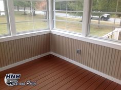 Screened porch with Eze-Breeze panels, vinyl bead board knee wall in Wicker, and Trex Transcends Tiki Torch flooring.