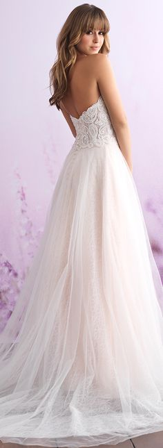 Wedding Dress by Allure Bridals - Topped with a beaded embroidered bodice, this strapless A-line gown layers tulle and lace.