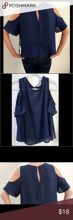 """NWT 2 Versatile Navy Cold Shoulder / Flow Tops 🔹2 NWT'S Active USA Cold Shoulder Short Sleeve Navy Blue Blouses    • """"In Style"""" So Versatile, Perfect For Work, Casual, Going Out, It Can Literally Be Dressed Up Or Down  • 2 Size Large - Per Brand Run A Little On Small Side, Approx 1 full Size(Keep That In Mind)  • Cute Open Back Space W/  Round Button (Comes w/ Extra Button)  • Has Some Sheer Flows & Lightweight  • Approx: 19""""L x 22"""" W, Neck Opening 11.5"""" • Has Some Curve @ Bottom All…"""