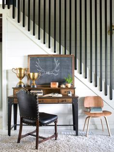 The original banister and railing were swapped out for black powder-coated tubular steel rails from Grey Furniture. The rails extend all the way to the ceiling to help highlight the open living and dining area's soaring height.