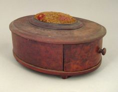 Burl veneer oval sewing box, early 19th c., with a single drawer and bun feet