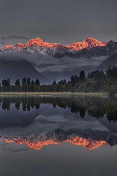 Sunset Reflection Of Lake Matheson, with Mount Tasman and Mount Cook, NZ, by Colin Monteath, on Fine Art America.
