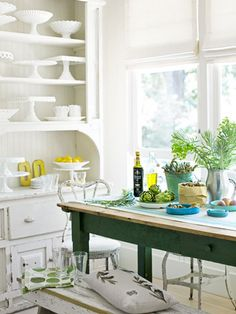 A painted hutch, pine farm table, and metal bistro chairs add character to this farmhouse #kitchen. #decorating