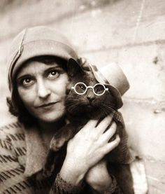 Photo of the American artist Wanda Gag (1893-1946) with her cat. She illustrated the children's book, Millions of Cats (1928), and pioneered the double-page book spread, using both pages for one illustration that furthered the story.