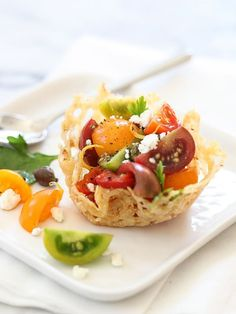 Simple and summery, this tomato caprese appetizer is served in a baked and shaped salty parmesan bowl of its own for easy finger food.