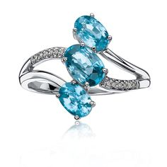This 10 karat ring features three vertically set oval blue zircon stones accented by a bypass of glimmering diamonds!