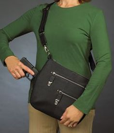 This selected item features our exclusive FREE SHIPPING -- $124.95  The GTM-0023 Concealed Carry Chrome Zip Leather Handbag by Gun Tote'n Mamas, sleek, yet not too trendy, with a fast draw feature.  Designed in classic style for day or night, the concealed carry gun compartment is sized for small automatics only such as Ruger LCP to maintain the slim bag profile.