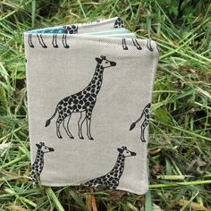 This is a handmade fabric passport cover. It measures x x This cover is made to fit a European Union, US or UK passport. The fabric used is a medium weight cotton with a giraffes design. Passport Cover, Travel Gifts, Giraffe, Patches, Reusable Tote Bags, Fabric, Sleeves, Handmade, Design