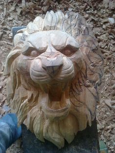 escultura la cabeza de un leon