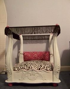 Dog bed made out of an end table/night stand. I could make a nice little canopy for it too