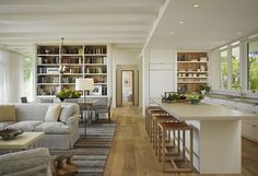 Inspiring Living Room Ideas to Decorate with Style. wide plank floors, frameless door, neutral colors