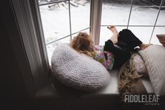 girl-looking-out-window-by-Kelly-Marleau-of-Fiddle-Leaf-Photography-840x559.jpeg (840×559)