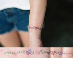 Floral wristband tattoo. Tattoo artist: Sol Tattoo