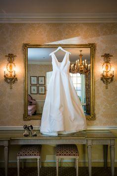 Elegant white wedding dress with plunging neckline by Carolina Herrera