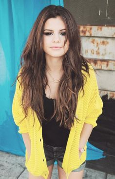 Selena Gomez rising disney star with beautiful highlights on brunette wavy locks.  Long thick lovely hair too. WANTT
