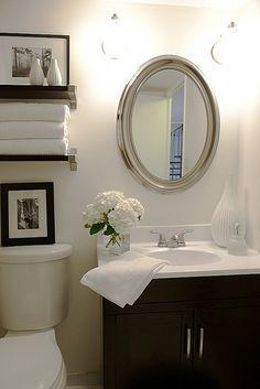 Chic small bathroom design with oval silver beaded mirror, espresso modern bathroom vanity & shelves {IKEA EKBY BJÄRNUM shelves & brackets} Bad Inspiration, Bathroom Inspiration, Bathroom Ideas, Bathroom Interior, Bath Ideas, Bathroom Renovations, Bathroom Layout, Bathroom Updates, Bathroom Colors