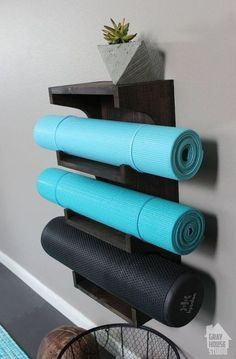 Small-Space Home Gym Hacks for Your Tiny Apartment Keep your yoga mats on display with this DIY rack.Keep your yoga mats on display with this DIY rack. Basement Gym, Garage Gym, Basement Ideas, Basement Entrance, Garage Attic, Attic House, Basement Bedrooms, Small Home Gyms, Small Homes