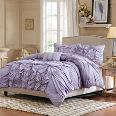 Add a touch of texture to your master suite or guest bedroom decor with this chic cotton percale comforter set, showcasing gathered ruffled details and ruche...