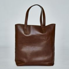 CLEMMIE TOTE BAG | Chestnut leather. £95