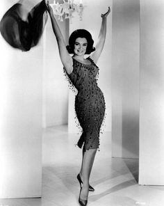 Connie Francis wearing a dress by Don Loper.