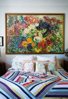 Beautiful bedrooms to inspire an update: Handmade patchwork quilts and cushions covers alongside vibrant artworks in the artful home of Rosita Missoni in the Lombardy countryside.
