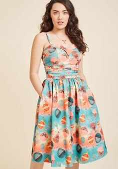 <p>This colorful midi dress is so breathtaking, its brilliance simply begs to be shared with others! Butterfly-detailed hot air balloons take flight atop the pleated waistline and swingy skirt of this silky sundress, as a skyscape of blue, pink, and yellow hues send you adrift into sweet sartorial reveries.</p>