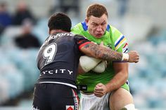 Shannon Boyd of the Raiders  is tackled by Issac Luke of the Warriors during the round 20 NRL match between the Canberra Raiders and the New Zealand Warriors at GIO Stadium on July 23, 2016 in Canberra, Australia.