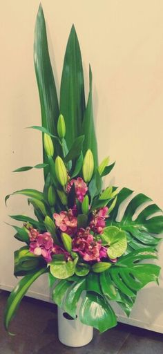 Tall corporate vase arrangement in pinks and greens - oriental lillies, antheriums and orchids