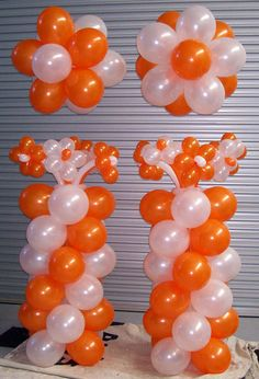 Lovely bright orange and white spiral balloon columns with matching balloon flowers. Balloon Pillars, Balloon Tower, Balloon Stands, Love Balloon, Balloon Arch, Balloon Ideas, Balloon Crafts, Balloon Decorations Party, Birthday Party Decorations