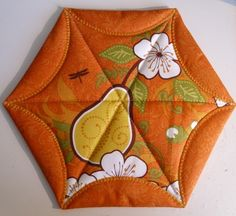 .Quiltscapes. Half hexie potholder!  You tube tutorial.  Would make super cute holiday gifts!