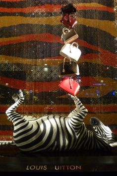 This Zebra has a lot of Louis Vuitton purses. via Very Very Chic