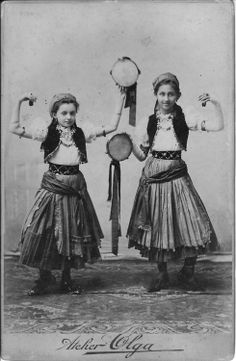 Two young Gypsy girls with tambourines in Romania