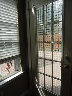 Very cool tutorial to add the frosted glass designs to your door instead of curtains.