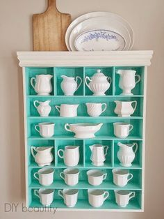 This cabinet formerly housed ribbon and craft supplies! I painted it a tiffany blue and repurposed it to showcase my collected Ironstone! DIY beautify