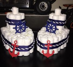 This listing is for 1 adorable nautical theme diaper cakes will surely be one an amazing piece to have at your celebration. This diaper cake is made from quality products and wont disappoint.  Looking for a smaller or larger cake, custom design please inquire.  rushed orders welcomed  Make it a themed party; banner, favor boxes and favor stickers also available in my Etsy store pictures shown above