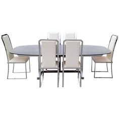 This 1970s dining set featuring an extendable dining table and six high-back chairs is in the style of Milo Baughman.
