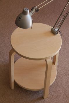 Materials: Frosta Stool x 2, Antifoni Work Lamp, Angle Brackets x 4, Cord Tidy x 2 Description: Using a couple of Frosta stools and an Antifoni lamp, I've created a Frosta side table with a built in light. I wanted an small side table with a lamp on it – however simply placing a lamp [&hellip