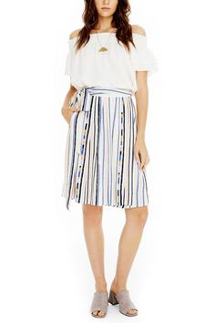 377767e4e7 Sweet and feminine striped skirt with tie-waist and vertical pastel stripes  on a cream. Shoptiques