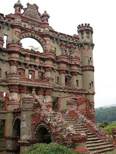 "Bannerman's Island, Hudson River, NY — aka Pollepel Island. "" . . . [D]esigned the buildings himself and let the constructors interpret . . . on their own."" Ceased construction 1918, and part of it blew up in 1920.  Island & structures bought by NY in 1967 for tourism, but all the roofs & floors were gutted by a fire in '69, making it even more unsafe, so it was declared ""off-limits to the Public"". Now, it's the property of the State of NY,"