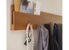 Coat rack with storage slot. Would be great to mount within kid-reach for book storage plus pajamas/clothes/etc.