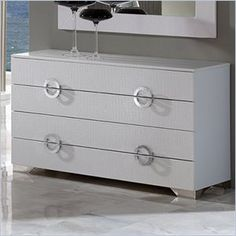 Dupen Coco Dresser in White - This bedroom collection offers an elegant blend of traditional elements with modern simplicity of lines that produces a unique and rich flair perfect for any contemporary bedroom. The collection oozes a luxurious Hollywood chic that you can bring and enjoy in your own private haven.    Features: Four drawers Made in Spain  Specifications: Product Weight: 141lbs Overall Product Dimensions: 28H x 48W x 20D