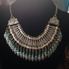 """EXOTIC SILVER AND TURQUOISE NECKLACE Silver tone necklace with turquoise colored beads, really beautiful and exotic piece. Measures 20"""" with 3.75"""" extender. Necklace can be clasped at whatever length you like. Secure lobster clasp closure. NEVER WORN Free People Jewelry Necklaces"""